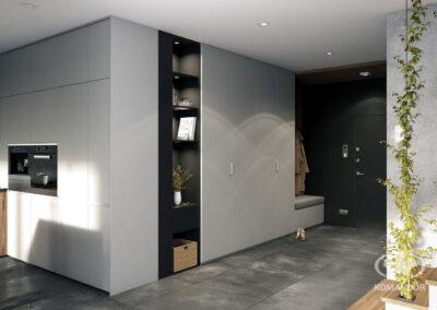 Az előszoba szekrényeibe beépített könyvespolc olyan elem, amely érdekes módon ötvözi a belső tér nyitott zónáit